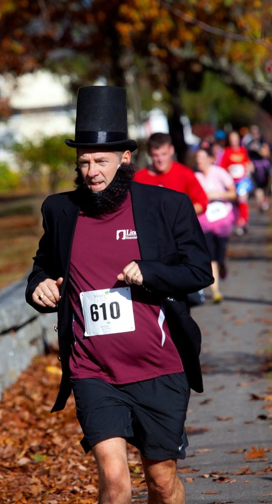Lief Martinson from the Lincoln Financial runners group makes his way to the finish line near Rollins Park Saturday at the Wicked Fit 5K race. The run supports Families in Transition (FIT), a nonprofit organization located in Manchester, Concord and Dover, New Hampshire, was founded in 1991 in response to the growing number of homeless individuals and families in the greater Manchester area and throughout the state. - See more at: http://www.fitnh.org/#sthash.tyOWpbR8.dpuf