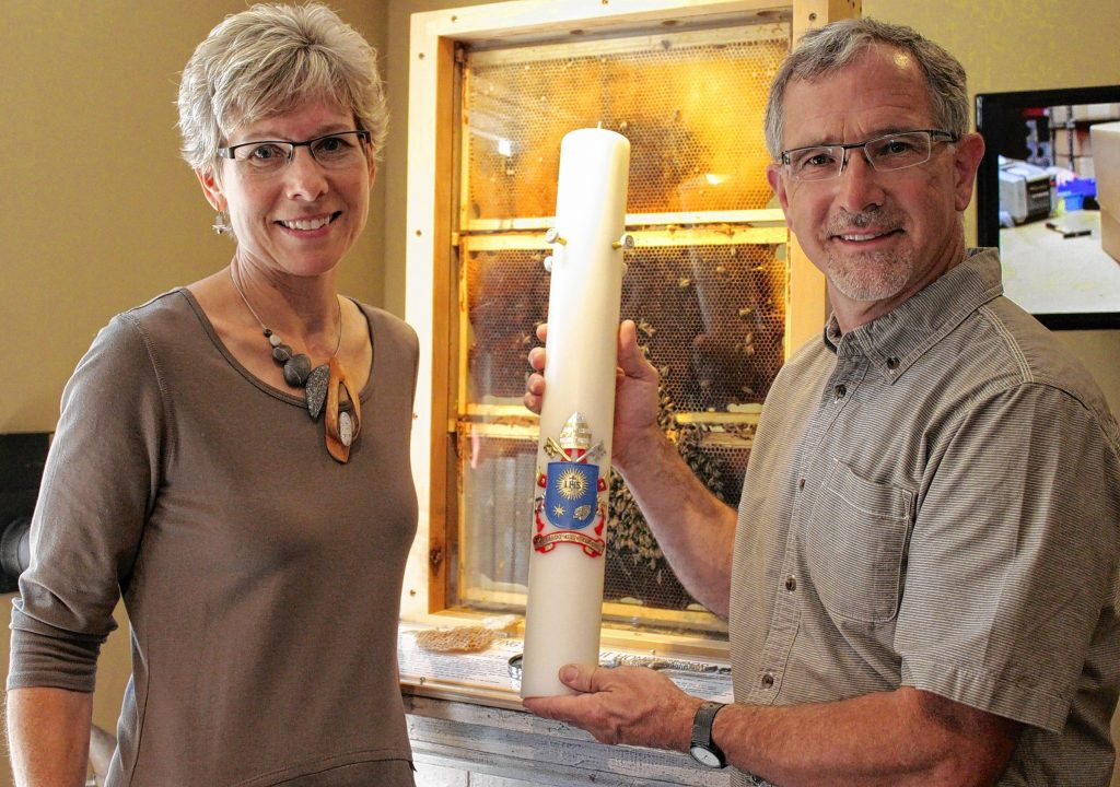 Martin and Christine Marklin of Marklin Candle Design shows off a candle made for Pope Francis's visit to the United States on Wednesday, Sept. 23, 2015. Martin Marklin's company specifically made this candle featuring the papal coat of arms for Pope Francis to light at a ceremony in New York City on Friday, Sept. 25, 2015.