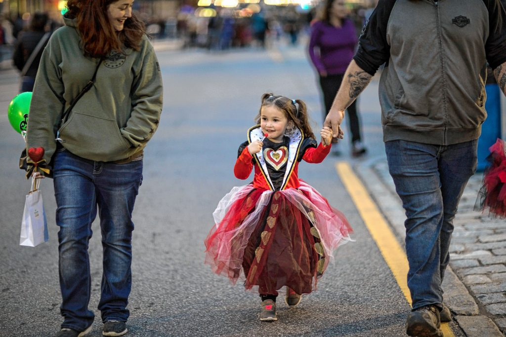 Elena Walker, 3, walks with her parents at the Halloween Howl in downtown Concord on Friday evening, October 25, 2019. GEOFF FORESTER