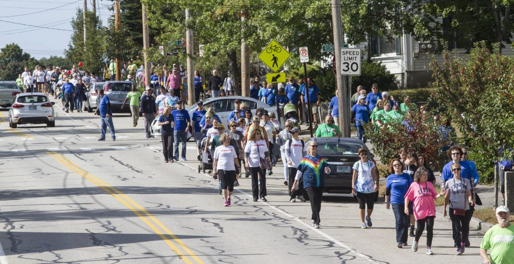 Participants in the NAMI Walk travel down Centre Street on Sunday, September 30, 2018. GEOFF FORESTER