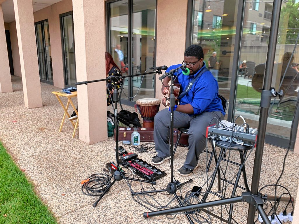 Musician Senie Hunt warms up before a performance at Courtyard by Marriott in Concord in July 2019. Courtesy of Duprey Companies