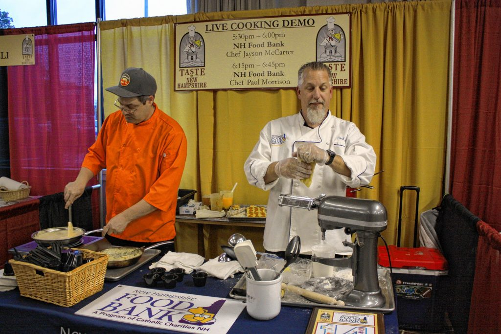 Jayson McCarter (right) and Paul Morrison with the New Hampshire Food Bank prepare some risotto as part of their live cooking demo at the 14th annual Taste of New Hampshire at the Grappone Conference Center in Concord on Thursday, Oct. 17, 2019. JON BODELL / Insider staff