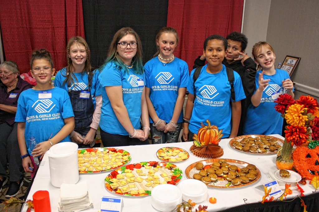 From left: Liliana Ketcham, Victoria Brown, Sadie Sullivan, Layla Young, Marcus Day, Michael Day and Amelia Richner, all with the Boys & Girls Club of Concord, man their table of pumpkin whoopie pies they made at the 14th annual Taste of New Hampshire at the Grappone Conference Center in Concord on Thursday, Oct. 17, 2019. JON BODELL / Insider staff