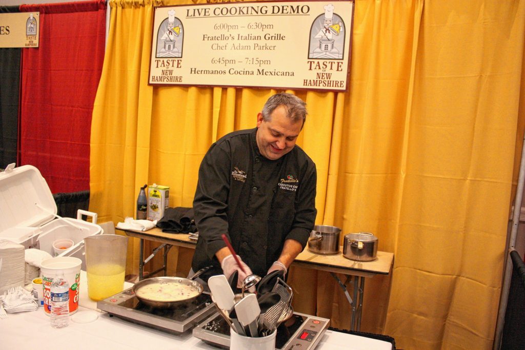 Adam Parker, corporate chef with Fratello's Italian Grille, whips up some risotto as part of his live cooking demonstration at the 14th annual Taste of New Hampshire at the Grappone Conference Center in Concord on Thursday, Oct. 17, 2019. JON BODELL / Insider staff