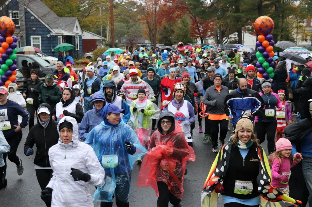 More than 250 people braved the weather, put on Halloween costumes and ran for Families in Transition-New Horizon at the seventh annual Wicked FIT Run in Concord on Oct. 27. The event raised more than $30,000 for FIT-NH. Courtesy of Families in Transition-New Horizons