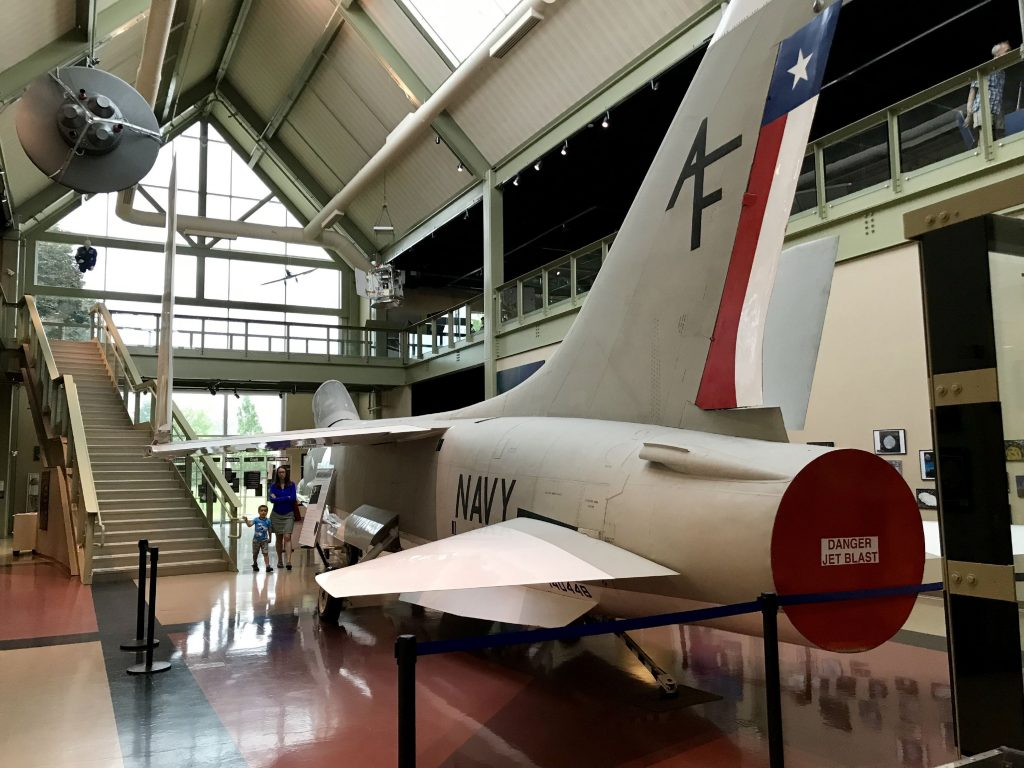 The McAuliffe-Shepard Discovery Center brings visitors up close to objects like this vintage 1956 XF8U-2 Crusader Jet tested by John Glenn and Alan Shepard before being selected by NASA.  Greater Concord Chamber of Commerce.