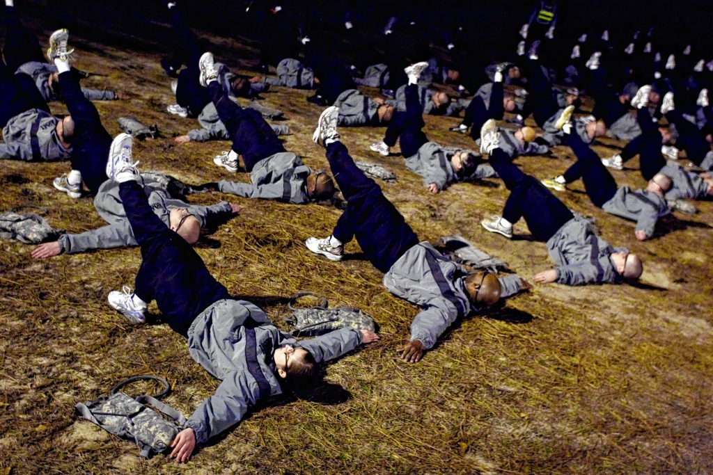 Third Platoon basic training soldiers at Fort Jackson, perform exercises in the Army's new physical training regimen during early morning PT in Columbia, S.C., Wednesday, Feb. 24, 2010. (AP Photo/Brett Flashnick) BRETT FLASHNICK