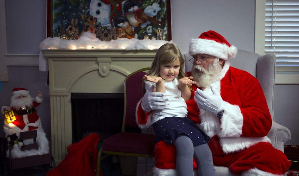 "Stella Moneysmith, 4, tells Santa she can't make up her mind on what she wants for Christmas at the 17th annual Bektash ""Fez-tival of Trees"" on Tuesday, November 21, 2017, The event runs through Sunday. GEOFF FORESTER"