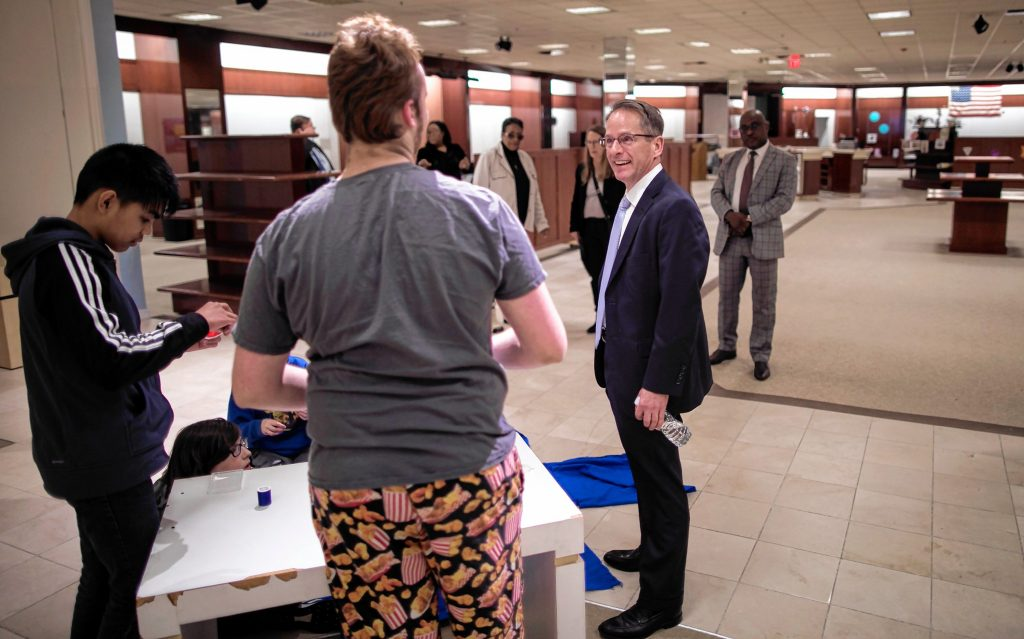 Commissioner of the Department of EducationFrank Edelblut talks with student at the Capital City Charter School in the Steepgate Mall on Thursday, November 7, 2019. GEOFF FORESTER