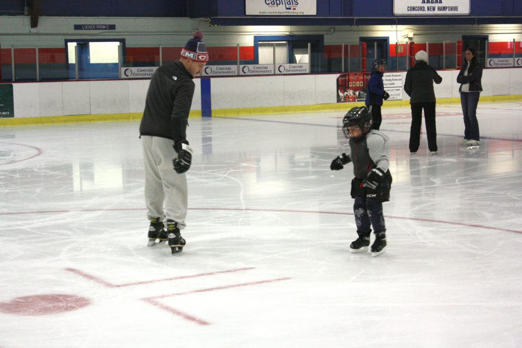 Carter Locke (right), 5, gets an ice skating lesson from his dad, Nate, at Everett Arena last week. There were a few slips and falls along the way, but that didn't stop these boys from having an ice time (see what we did there?). JON BODELL / Insider staff