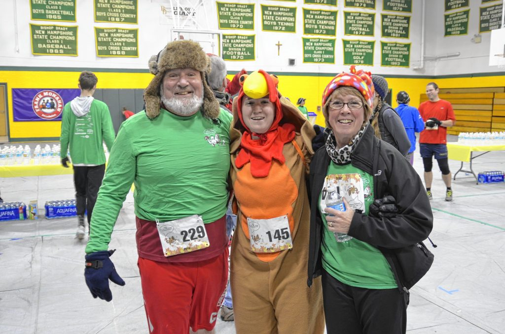 Participants pose for a photo in the Bishop Brady High School gymnasium after a previous Galloping Gobbler 4-miler road race on Thanksgiving morning. Courtesy of Bishop Brady High School