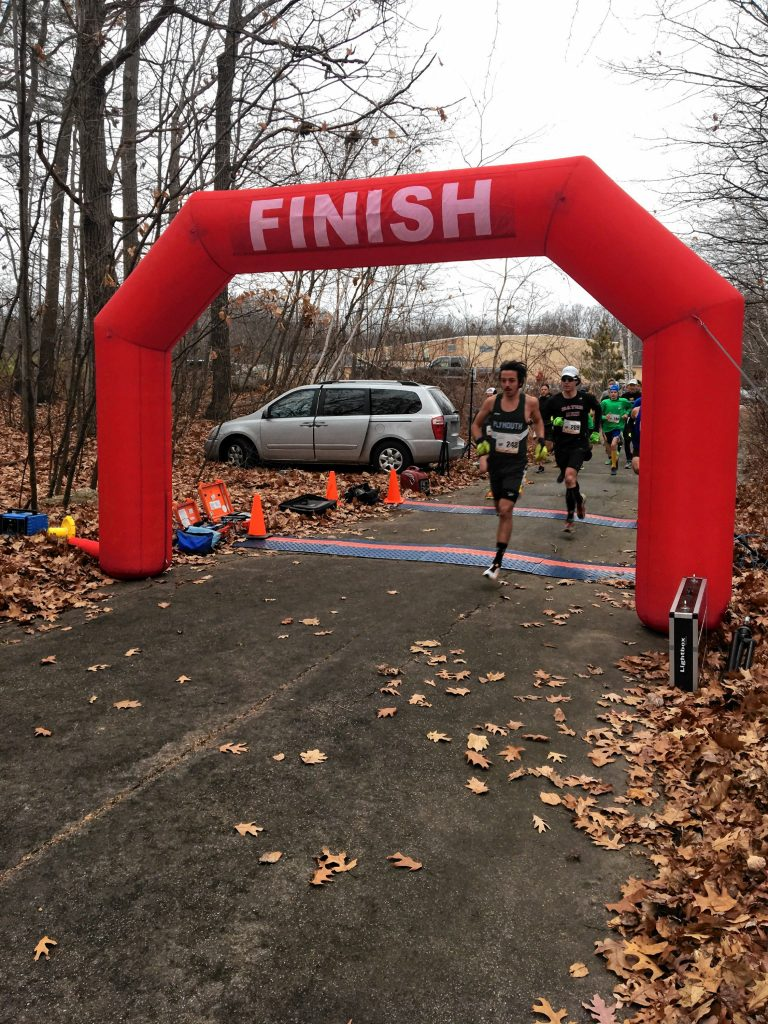 Participants cross the finish line at a previous Bishop Brady High School Galloping Gobbler 4-miler road race on Thanksgiving morning.  Courtesy of Bishop Brady High School