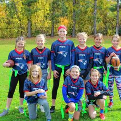 Elementary school girls hold their own against the boys in flag football