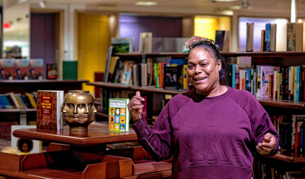 Stephanie C. Alicea, the Capital City Charter School's founder and head in the library of the school at the Steeplegate Mall is looking forward to expanded the school to include high school students. GEOFF FORESTER