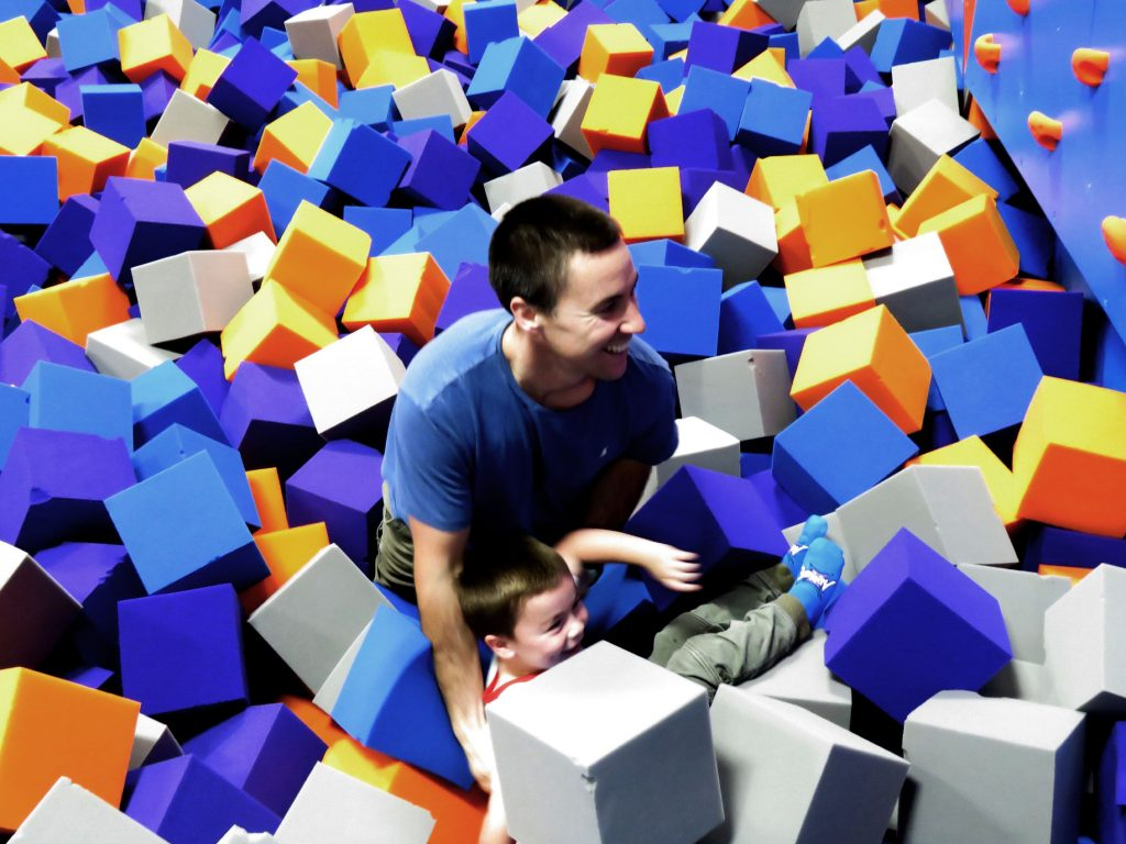 Ronnie Palmer plays with his son, Ronnie, in a foam pit at Altitude Trampoline Park in Concord's Steeplegate Mall on November 21, 2018. Caitlin Andrews