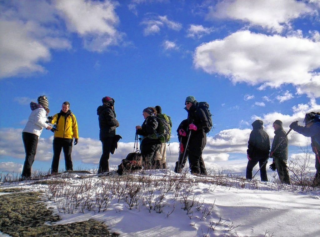 A group rests at a viewpoint during the First Day Hike at Mount Monadnock in 2013.