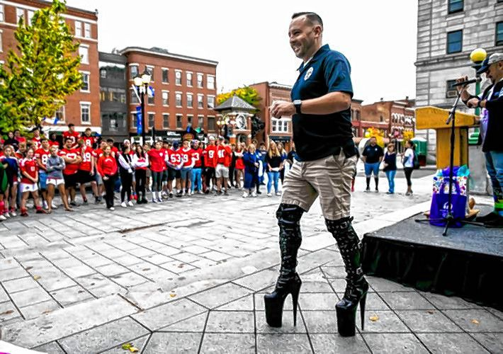 Concord Police Detective Dana Dexter leaves the podium after addressing the crowd before the annual Walk A Mile in Her Shoes event at City Plaza in front of the State House on Wednesday, October 2, 2019. GEOF