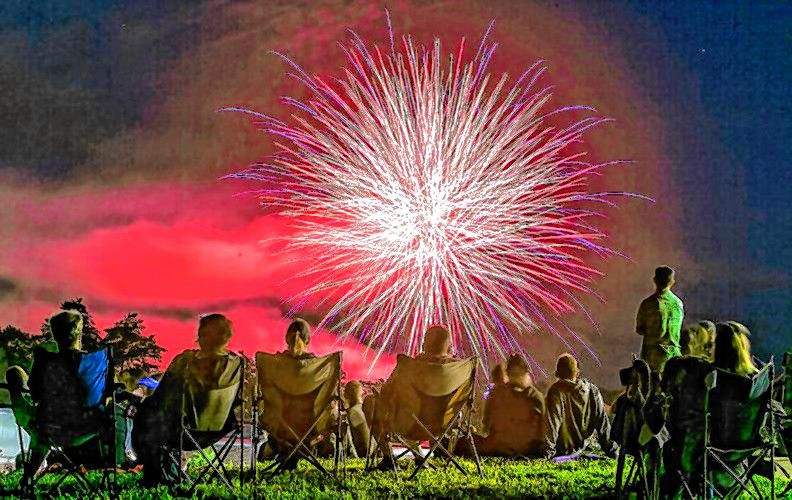 Onlookers at Memorial Field watch the Fourth of July fireworks in their lawn chairs on July 4, 2017. The hill on the State Hospital grounds also provides a unique vantage point to watch the fireworks show. Monitor file