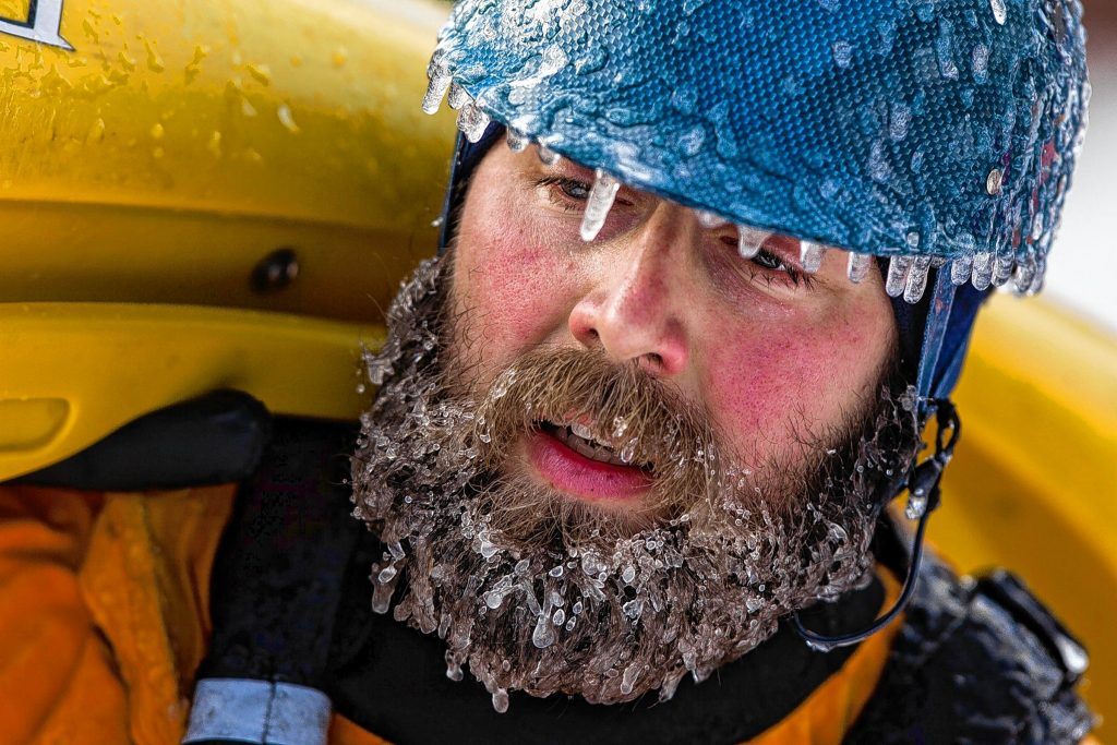 Dan Bennis of Spencer, Massachusetts, carries his kayak away from the shore of the Winnipesaukee River in Franklin during the annual First Day Kayak Run on Wednesday, January 1, 2014. Roughly 40 paddlers from the Merrimack Valley Paddlers and other New England outdoor associations battled class III and IV rapids while braving temperatures in the teens. (WILL PARSON / Monitor staff)