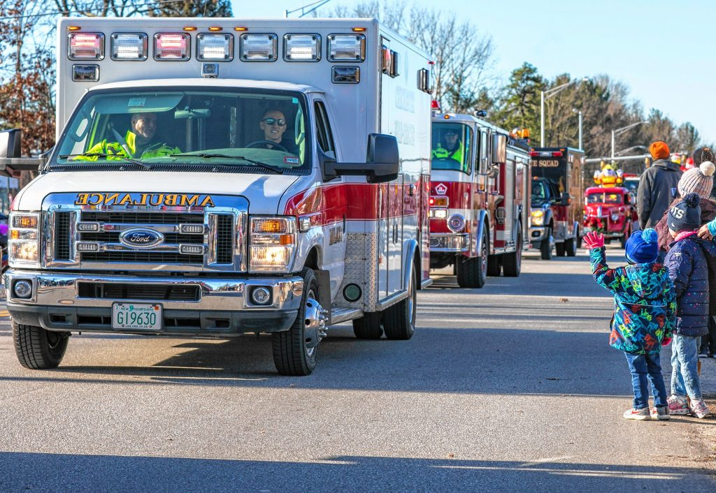 Cohen Trudell, 3, waves at the ambulances and fire trucks at the 68th annual Grange 322 Concord Christmas parade down Loudon Road on Saturday morning, November 23, 2019. GEOFF FORESTER