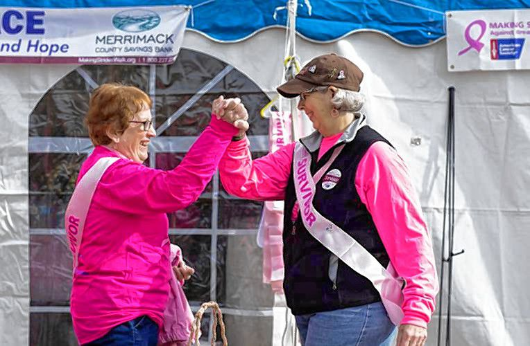 Here, survivor Nicolde Patenude (left) and Survivor committee member Terri Peick give a high-five outside the Survivor tent on Sunday, October 20, 2019 at Memorial field. GEOFF FORESTER