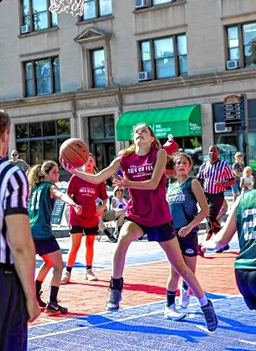 Incoming Concord High freshman Eva Woodman drives to the hoop against the Pembroke Academy team at the Rock On Fest on Sunday, August 4, 2019 on Main Street in front of the State House. The festival is the brainchild of Concord native Luke Bonner, who runs the Rock On Foundation, a 501(c)3 nonprofit that serves to increase community artistic and athletic opportunities in the community