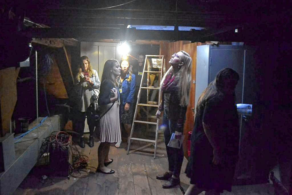 Visitors check out the attic at Parker Academy on Oct. 4, 2018, during the Upstairs Downtown tour. The building was the home of Lewis Downing Jr. and staff of the school say the attic light turns on without cause. Sarah Pearson