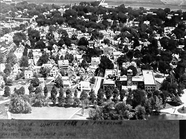 A photo slide of Concord's North End with White Park in the foreground.