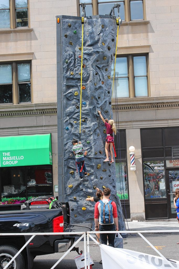 The rock climbing wall provided by Evo Rock + Fitness was quite a hit with the kids during Market Days.