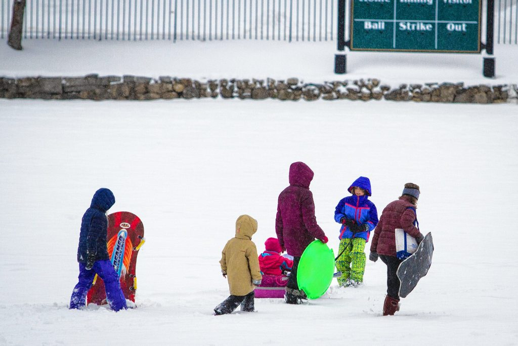 Students sled down a hill at White Park in Concord on Tuesday, Dec. 12, 2017. Luce, who attends Christa McAuliffe School, had a snow day and walked to the park with her mother. (ELIZABETH FRANTZ / Monitor staff) ELIZABETH FRANTZ