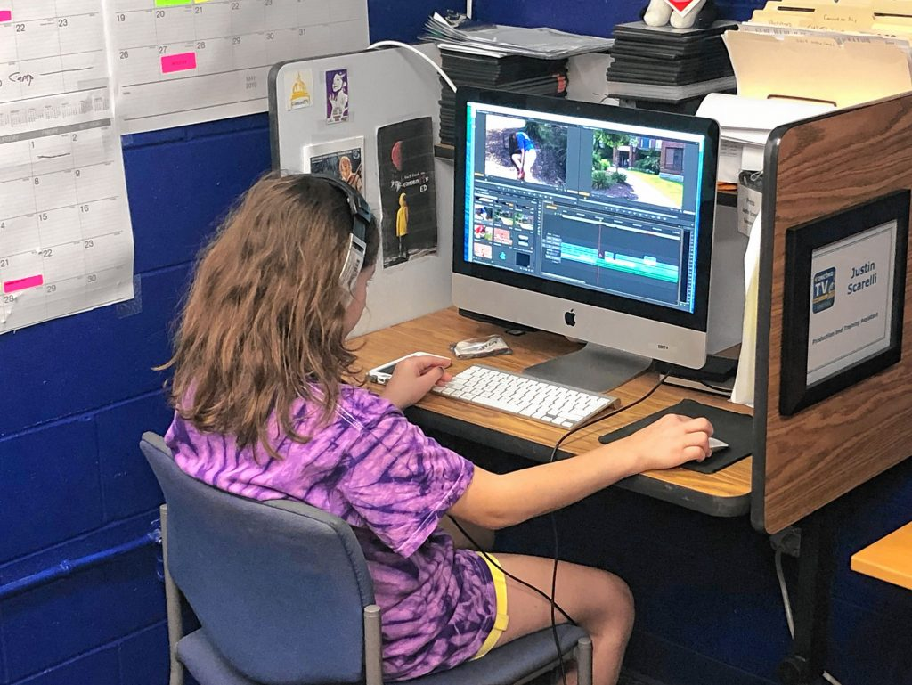 A ConcordTV Youth Video Camper learns some editing skills at the camp in 2018.