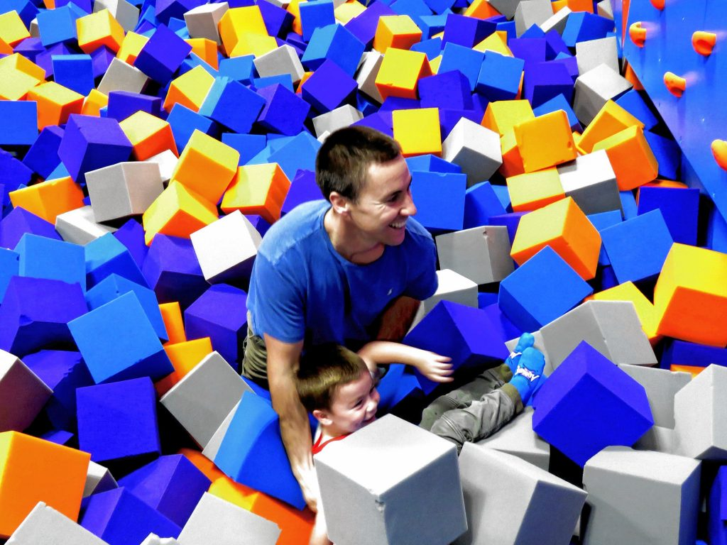 Ronnie Palmer plays with his son, Ronnie, in a foam pit at Altitude Trampoline Park in Concord's Steeplegate Mall on November 21, 2018.