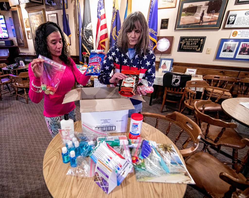 Kyme Locke (left) and her mother Barbara pack up items for the troops that she sent out along with letters from area school children at Post 21 in Concord recently. GEOFF FORESTER