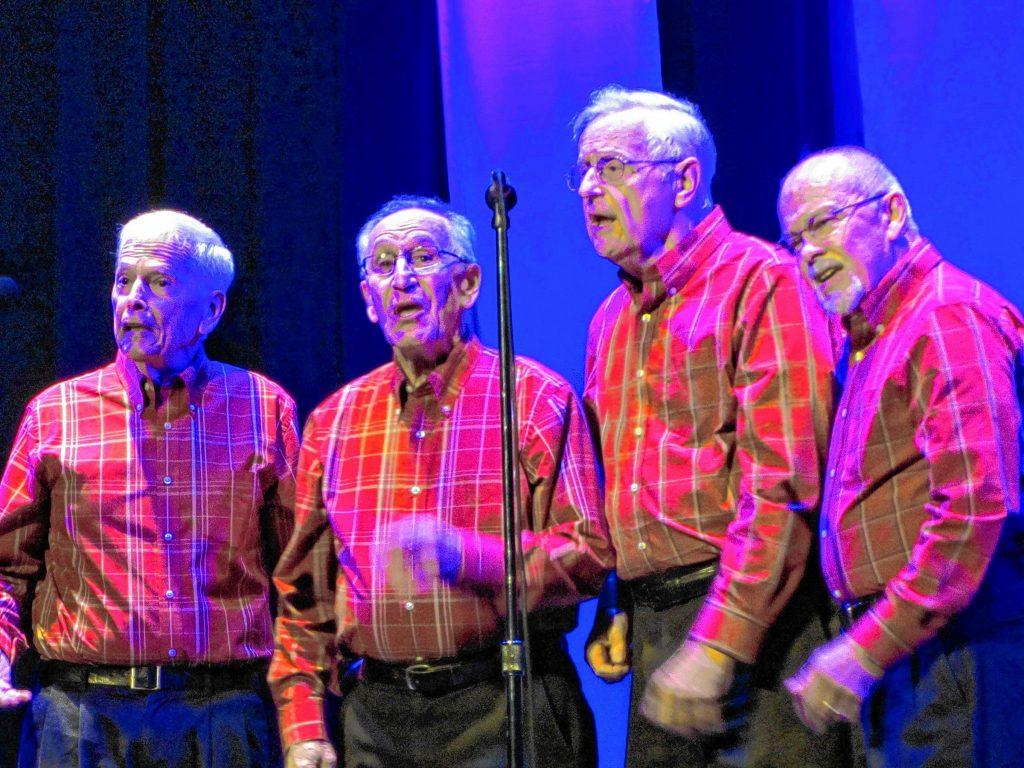 A barbershop quartet of members from the Concord Coachmen Chorus.