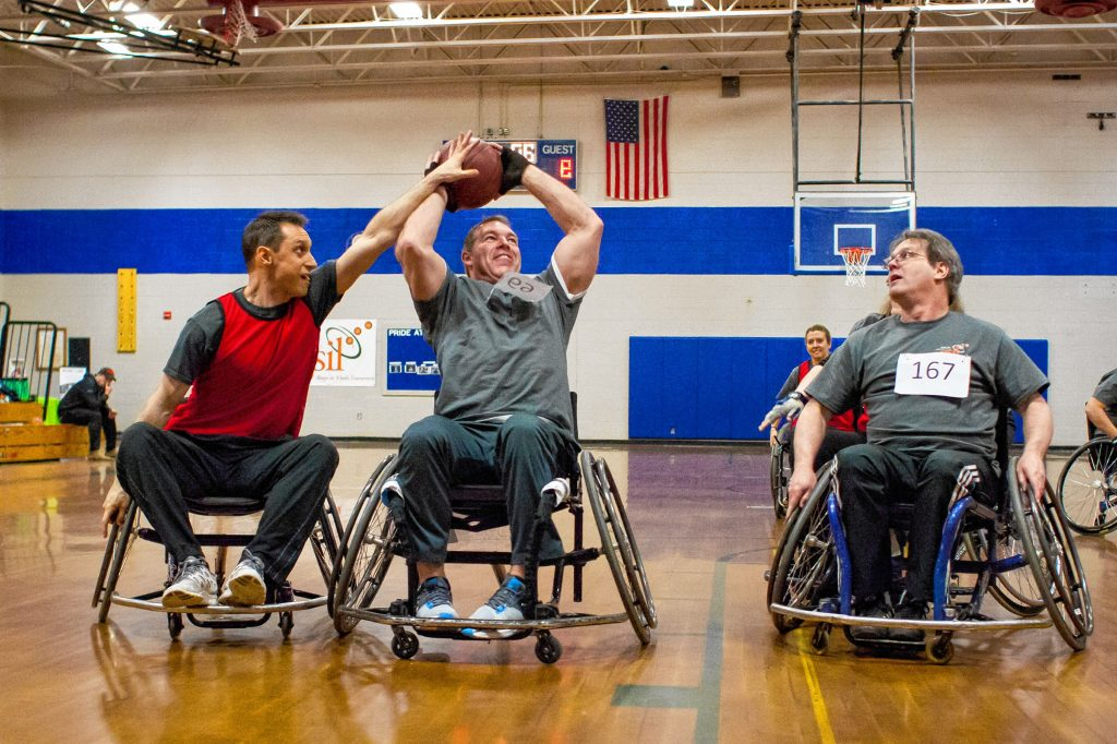 The PiF Technologies Scantastics and GSIL Wheelin' & Dealn' teams faced off during a recreational league game at this year's Hoops on Wheels event at Rundlett Middle School in Concord on Saturday, Mar. 3, 2018. The annual wheelchair basketball tournament is a fundraiser for Granite State Independent Living. (ELIZABETH FRANTZ / Monitor staff) ELIZABETH FRANTZ
