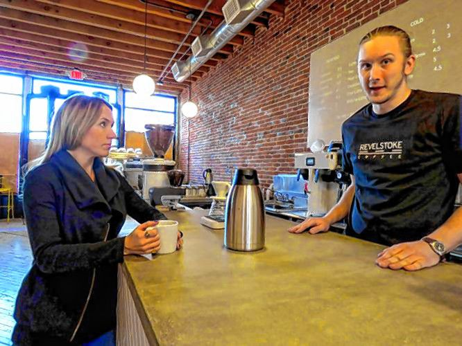 Revelstoke Coffee owners Lyndsey Cole (left) and Alex Stoyle hang out in their store in 2018.