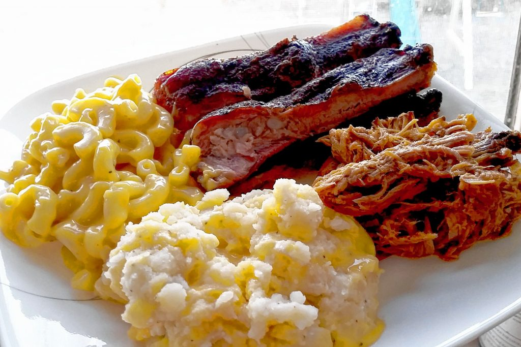 Pulled pork, ribs, mac and cheese, and loaded mashers from Smokeshow BBQ.