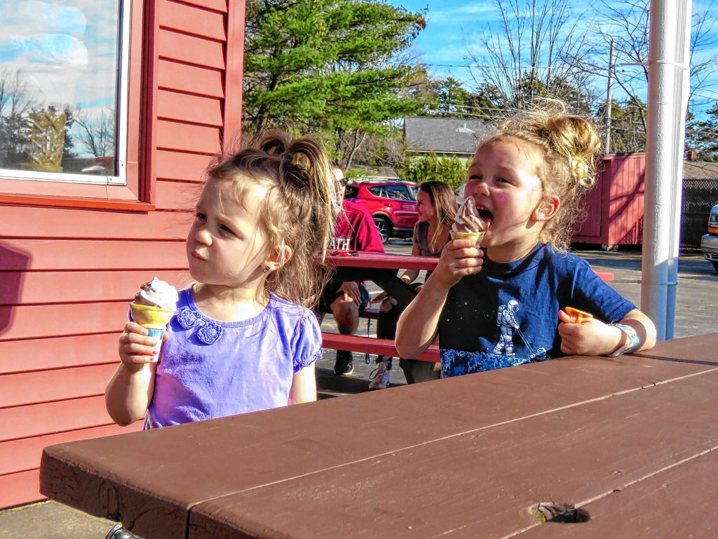 Adeline (left, 3) and Ella (5) Lundquist of Hopkinton eat a chocolate-vanilla twist ice cream cone at Arnie's Place on Wednesday, Feb. 21, 2018.