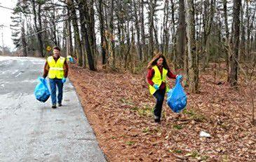 Pick up road trash with blue bag program.