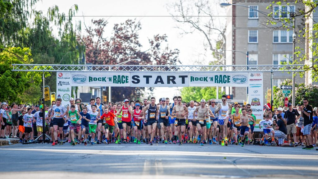 Runners leave the starting line at Rock 'N Race 5K in downtown Concord on Thursday, May 18, 2017. ELIZABETH FRANTZ