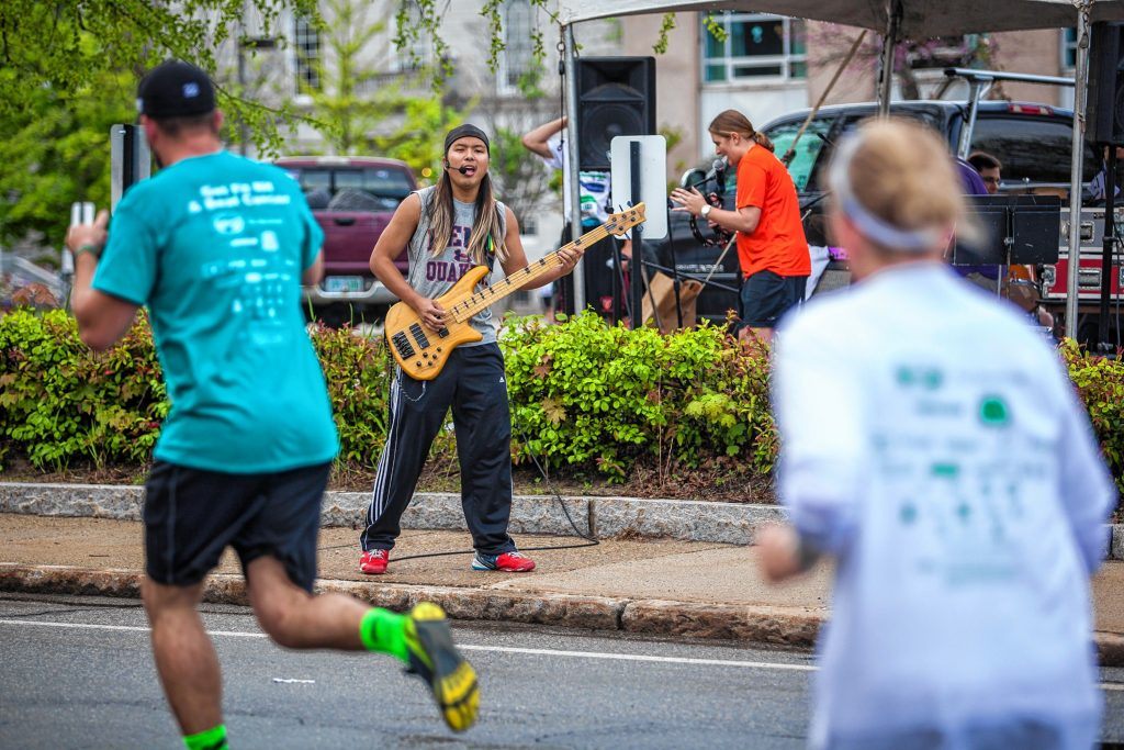 The Fletchtones perform as runners pass by during Thursday's Rock 'N Race 5K in downtown Concord on May 19, 2016. ELIZABETH FRANTZ