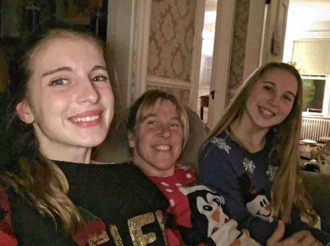 Molly Banzhoff (left) is pictured with mother Barb Higgins and sister Gracie. Caitlin Andrews