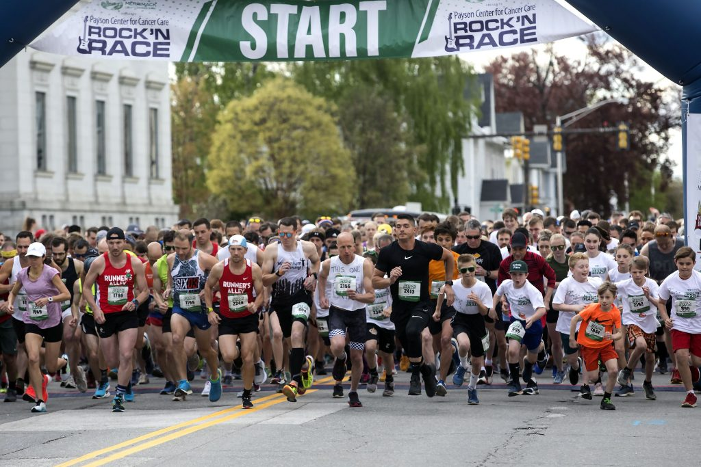Runners start at the 2019 Payson Center for Cancer Care's Rock 'N Race on North State Street in downtown Concord on Thursday, May 16, 2019.