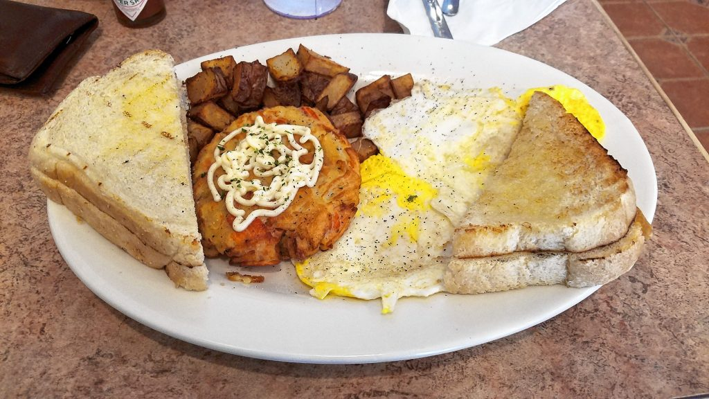 Carolina Crab Cake with eggs, home fries and homemade sourdough toast from The Post, the new breakfast and lunch restaurant on North Main Street. in downtown Concord. THE FOOD SNOB / Insider staff