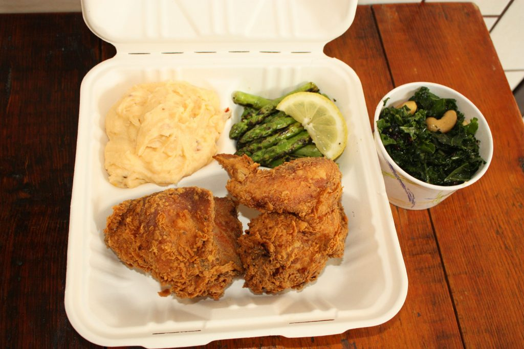 Fried chicken with chipotle mashed potatoes, grilled asparagus and collared greens from the not-yet-open Georgia's Northside. THE FOOD SNOB / Insider staff