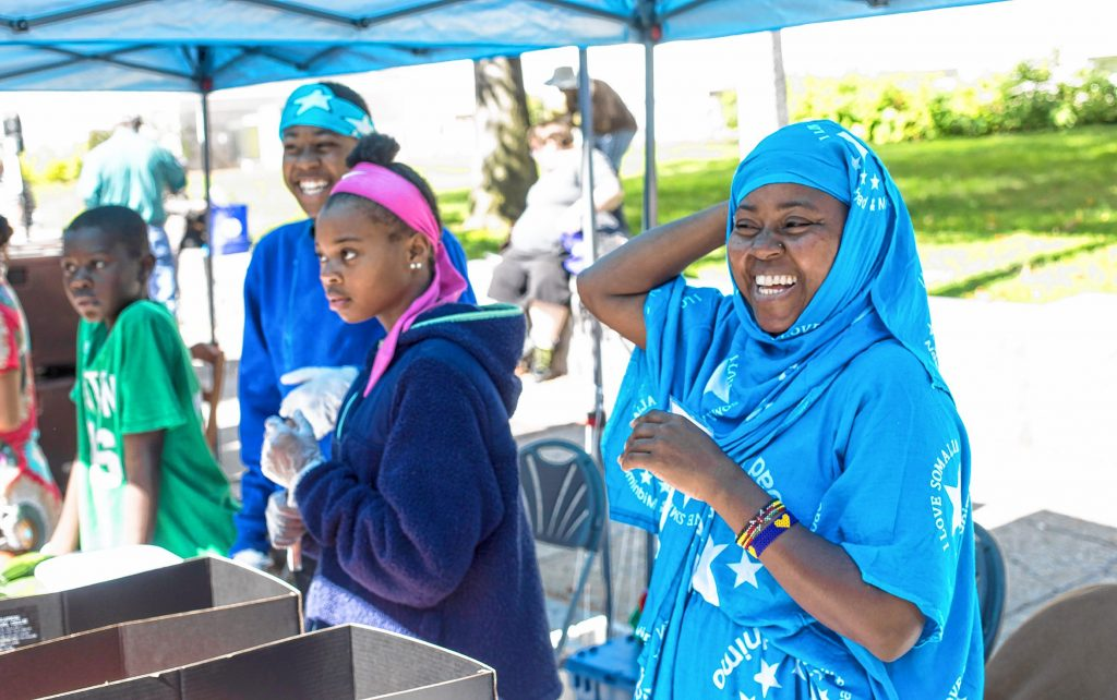 Batulo Mahamed (right) with her children, Mahamad (far right), Hassan, and daughter Sangabo at the Multicultural Festival at the State House on Sunday, September 22, 2109.