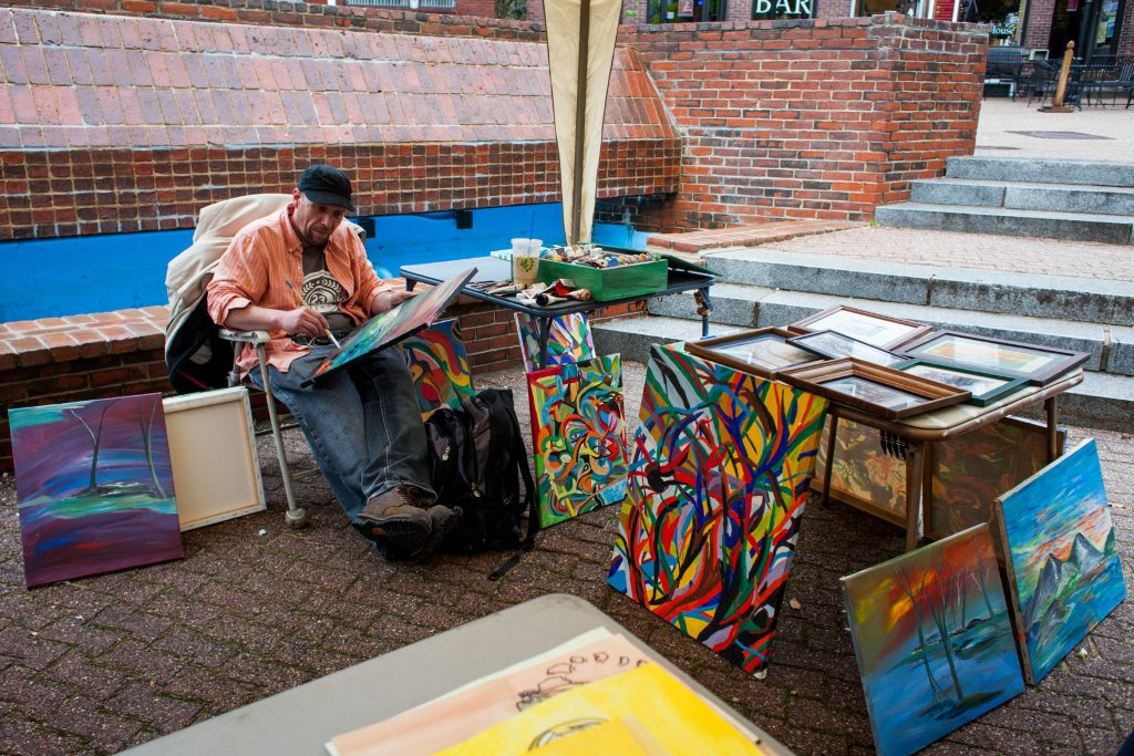 Ethan Clapp paints with acrylics with fellow artists in Bicentennial Square during Capital Arts Fest in Concord on Saturday, May 6, 2017. (ELIZABETH FRANTZ / Monitor staff) Elizabeth Frantz