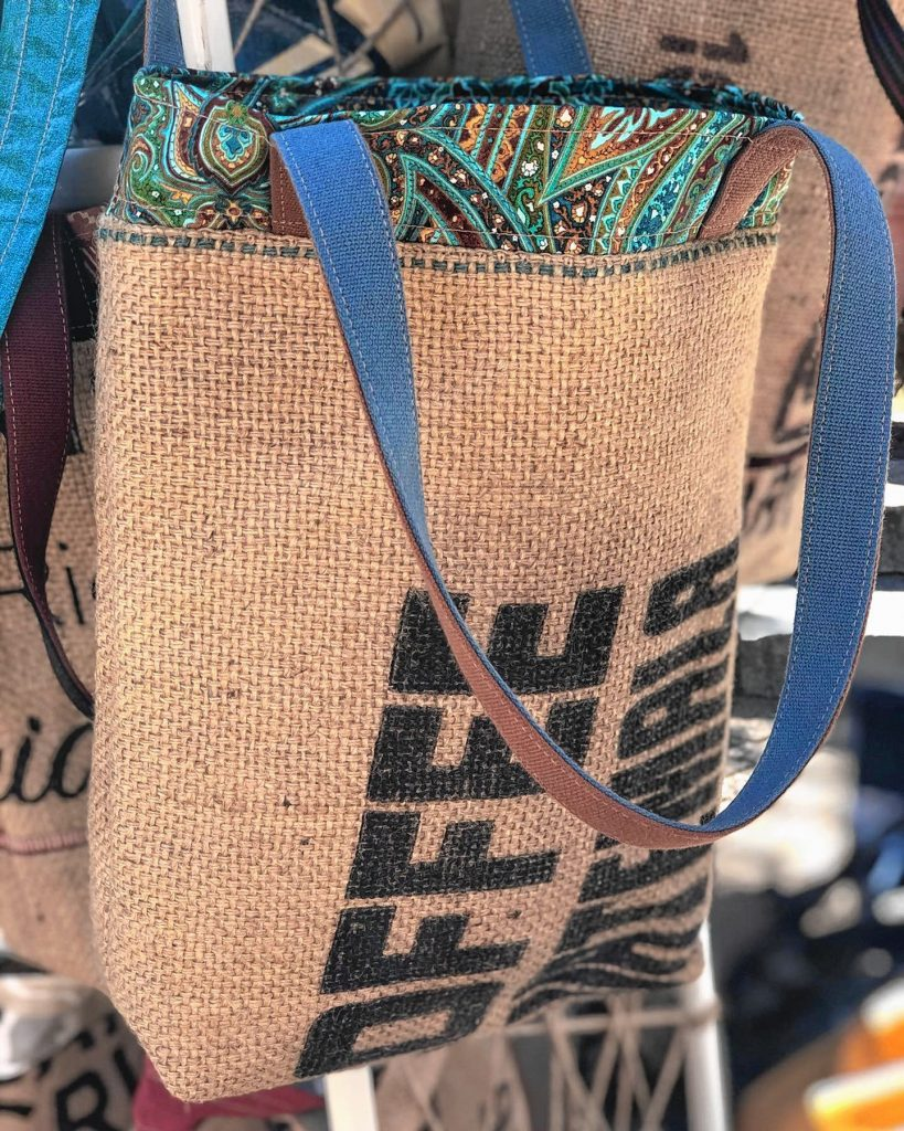 New World Designs upcycles coffee sacks and billboards into unique bags.