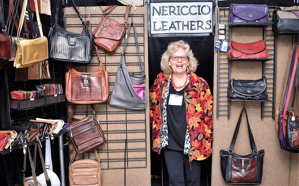 Diane Nericcio of Thorton poses with her handmade leather bags at the 2018 Capital Arts Fest in downtown Concord. This year's festival will run Sept. 27-29 on South Main Street in front of the League of N.H. Craftsmen headquarters.  Courtesy of League of N.H. Craftsmen