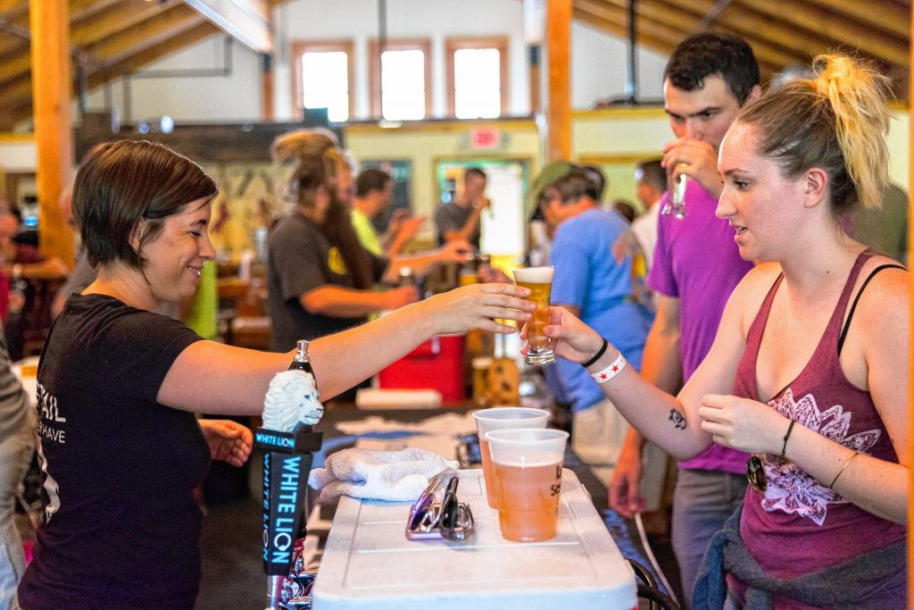 Ashley Clark, of White Lion brewery in Springfield, serves a beer to an attendee of Franklin County Beer Fest at Berkshire East in Charlemont Saturday, July 22, 2017. Recorder Staff/Matt Burkhartt